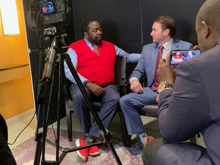 Chris Naugle talks with motivational speaker Les Brown